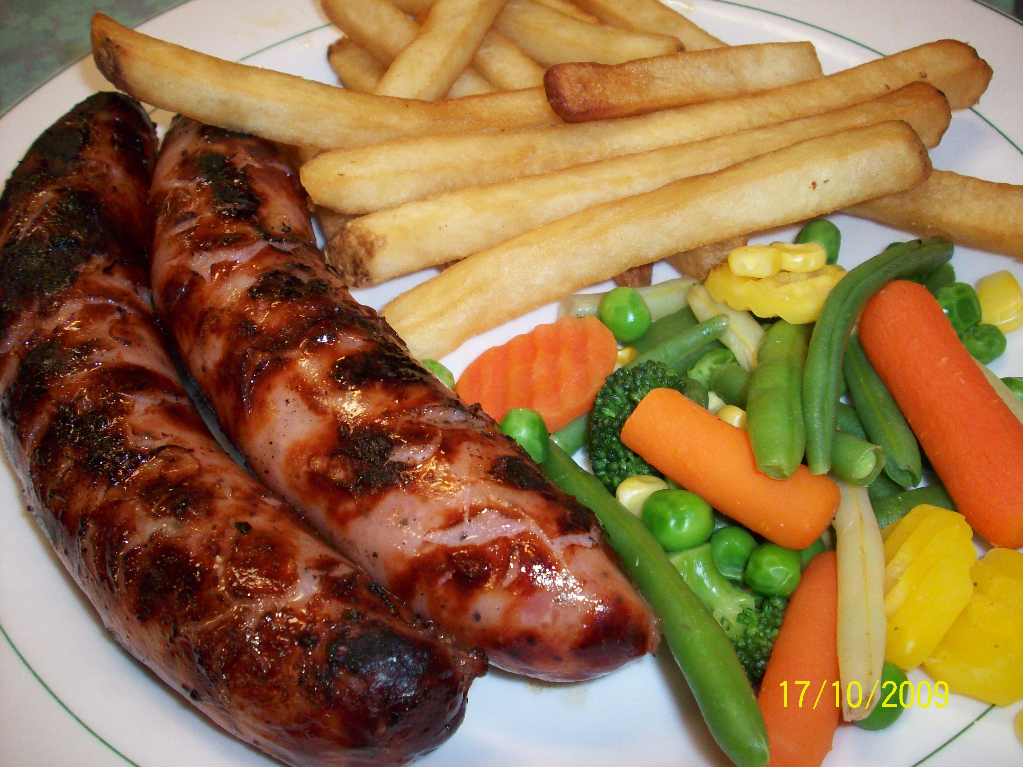 http://foodloader.net/cutie_2009-10-17_Burned_Sausages__Mized_Veggies_and_Fries.jpg