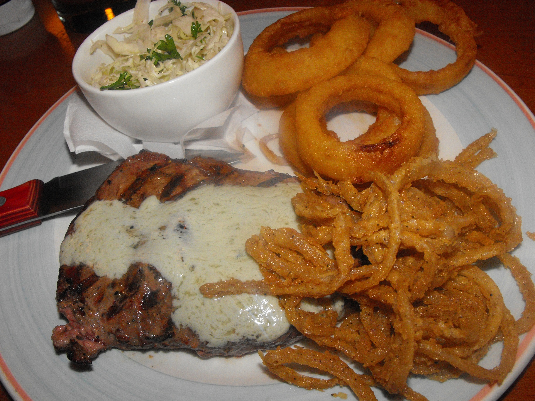 http://foodloader.net/cutie_2011-08-19_Blue_Cheese_Butter_Strip_Loin_with_Onion_Rings_and.jpg